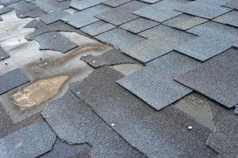 Damage asphalt shingles on a roof in San Antonio Texas