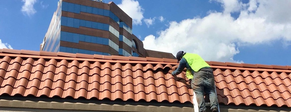Man installing a clay tile roof in San Antonio